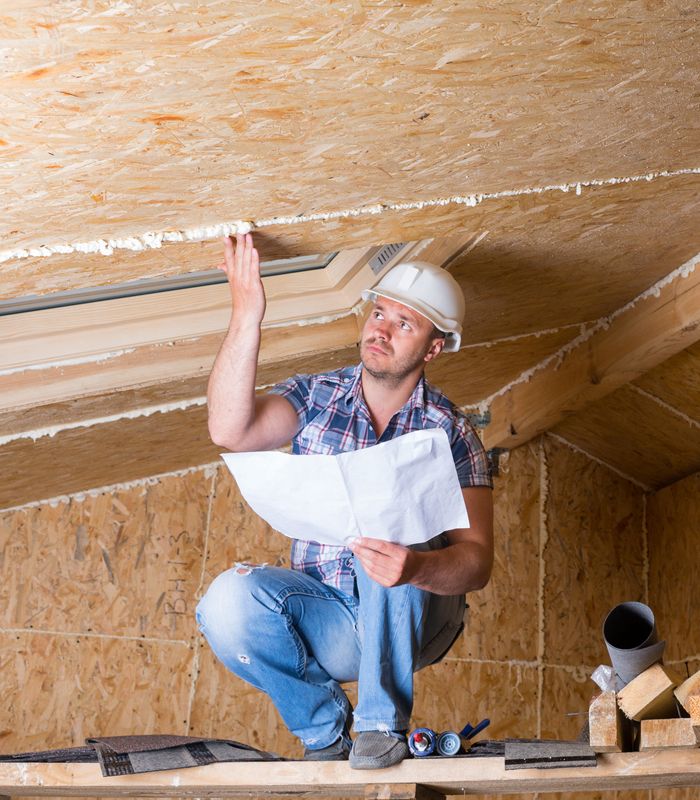 man inspecting roof from inside the home